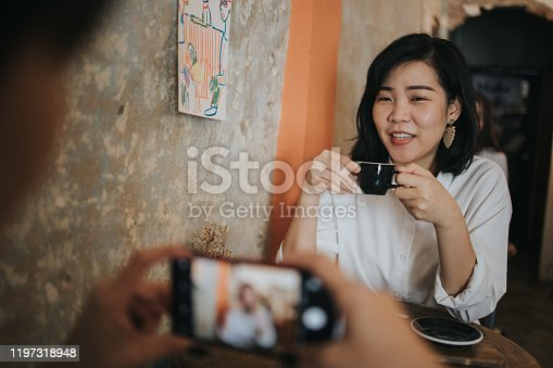 lifestyles, friendship, coffee shop, 30-34 years, women, women only, togetherness, using phone, photographing, hot drink, drinking, resting, Bangkok, Thailand