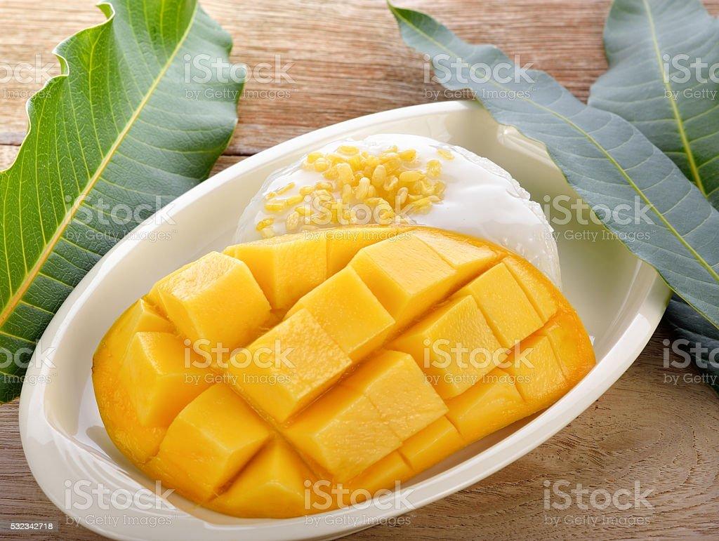 Thai  dessert, glutinous rice with mangoes stock photo