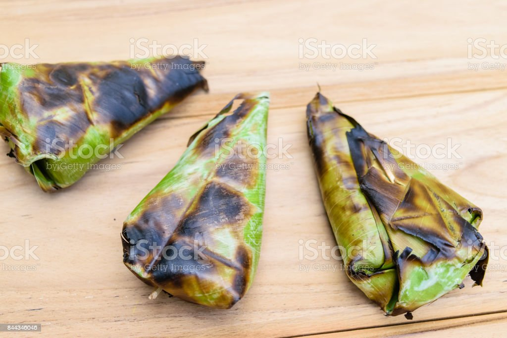 Thai Dessert - Sticky Rice with Sweet Potato wrapped by banana l stock photo
