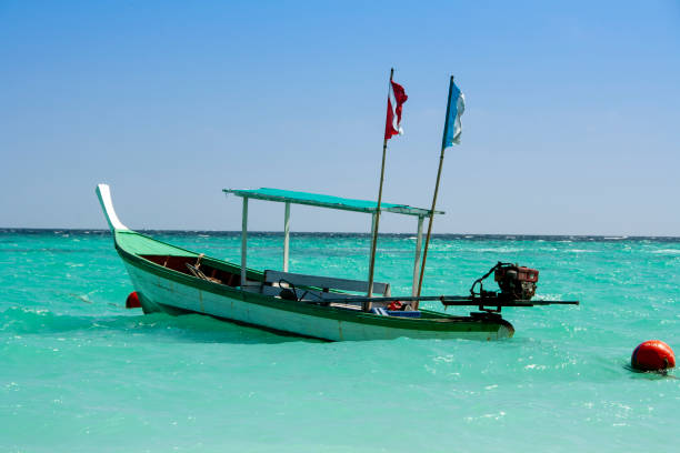 Thai diving boat in a clear blue sea stock photo