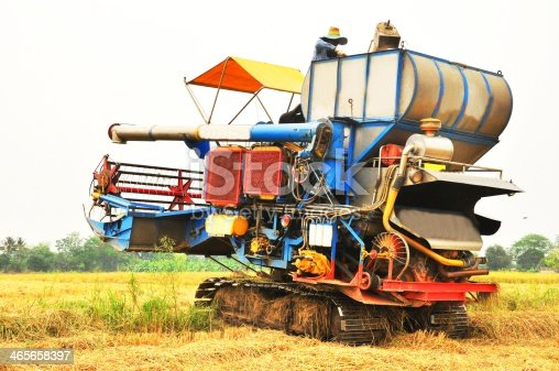 171320236 istock photo Thai farmers are using. Harvest is harvested at rice field 465658397