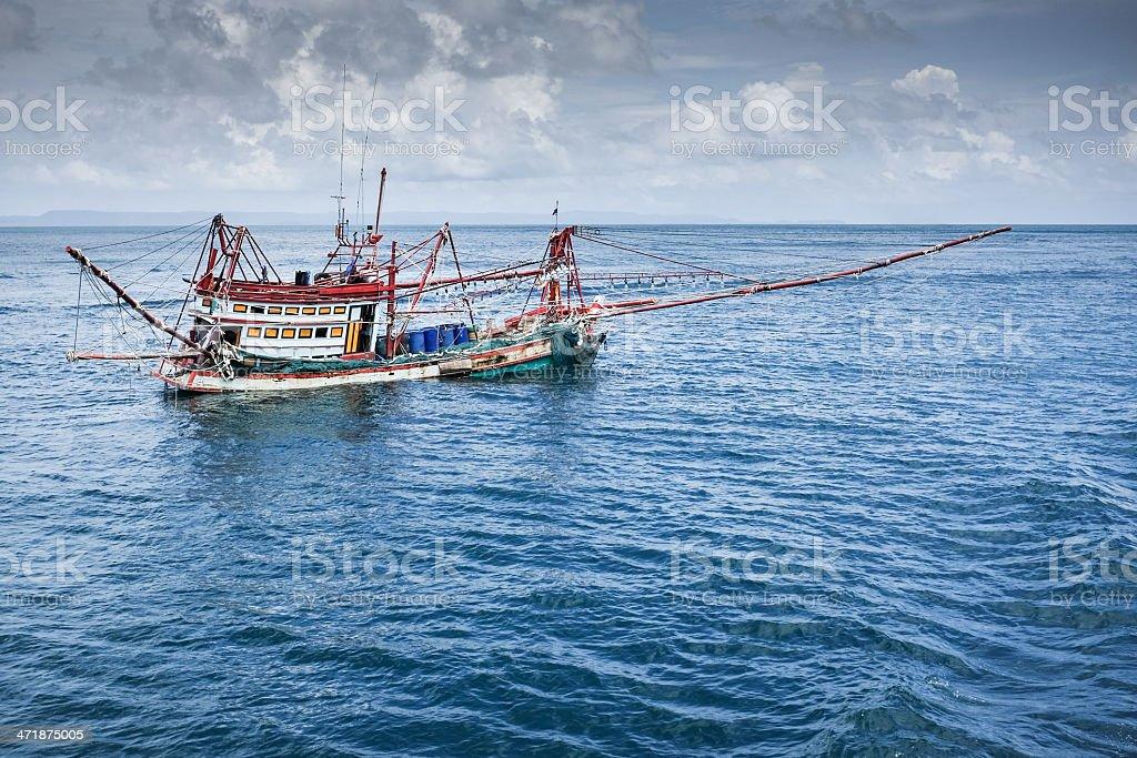 Thai Fishing Boat on Choppy Water stock photo