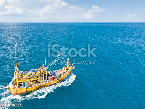 Thai Fishing Boat off the shore of Ko Samui, Thailand. Aerial Footage. Converted from RAW.