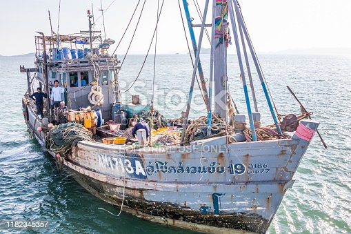 Koh Phayam, Thailand - April 5th 2019: Thai fishing boat with Burmese crew. Most Thai boats have Burmese crew.