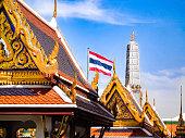 Grand Palace: Thai Temples, Golden Rooftops, and Thai Flag - Bangkok, Thailand