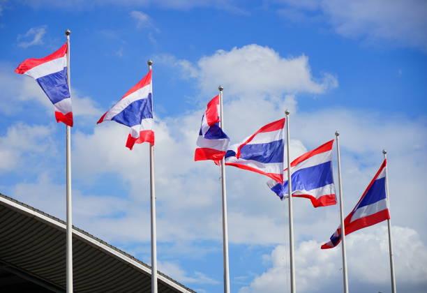 Thai flags wavy with sky stock photo