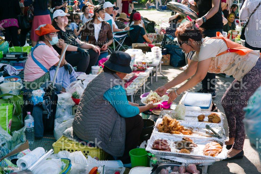 Thai food market in public park (Preussenpark) in springtime royalty-free stock photo