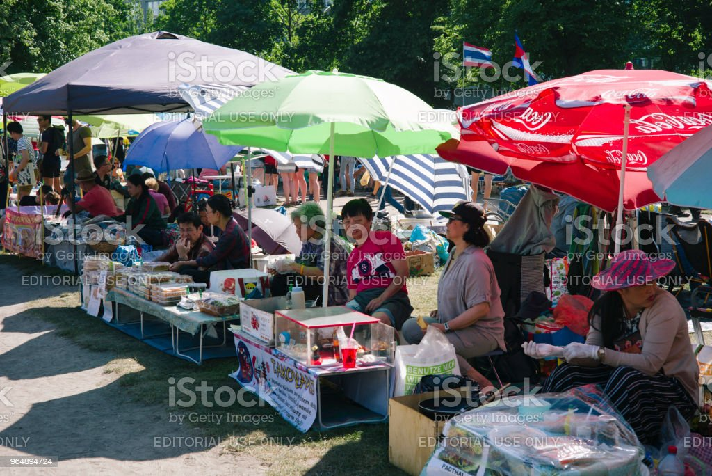 Thai food market in public park (Preussenpark) in springtime royalty-free stock photo