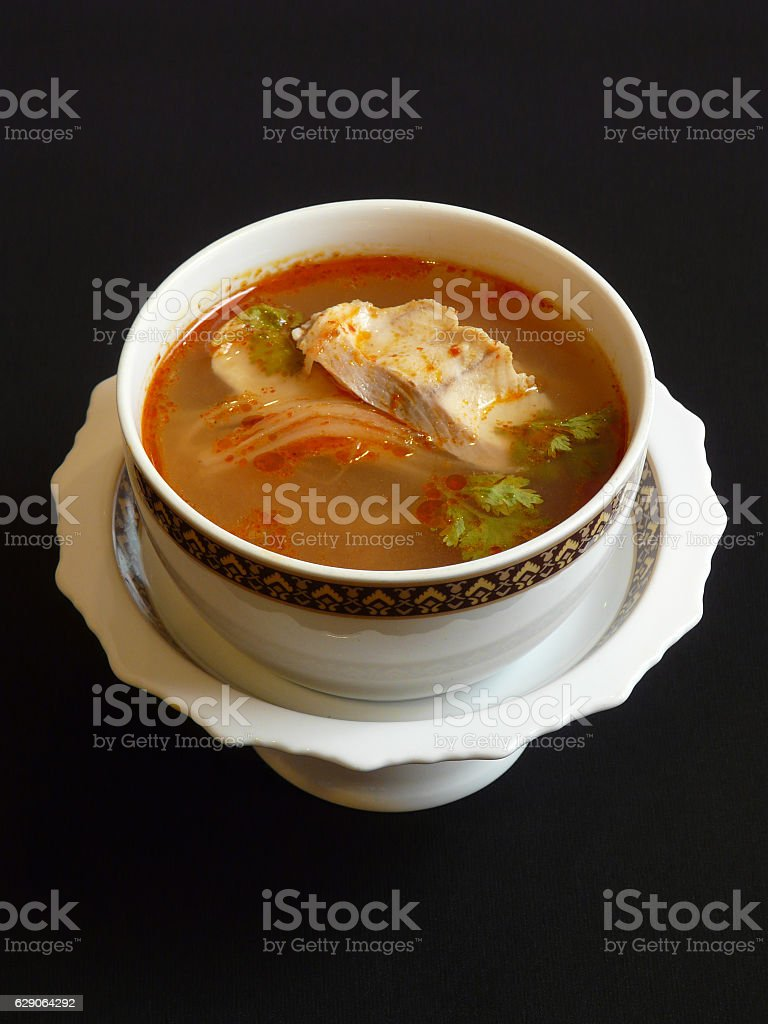 thai food - spicy soup with fish and lemongrass stock photo