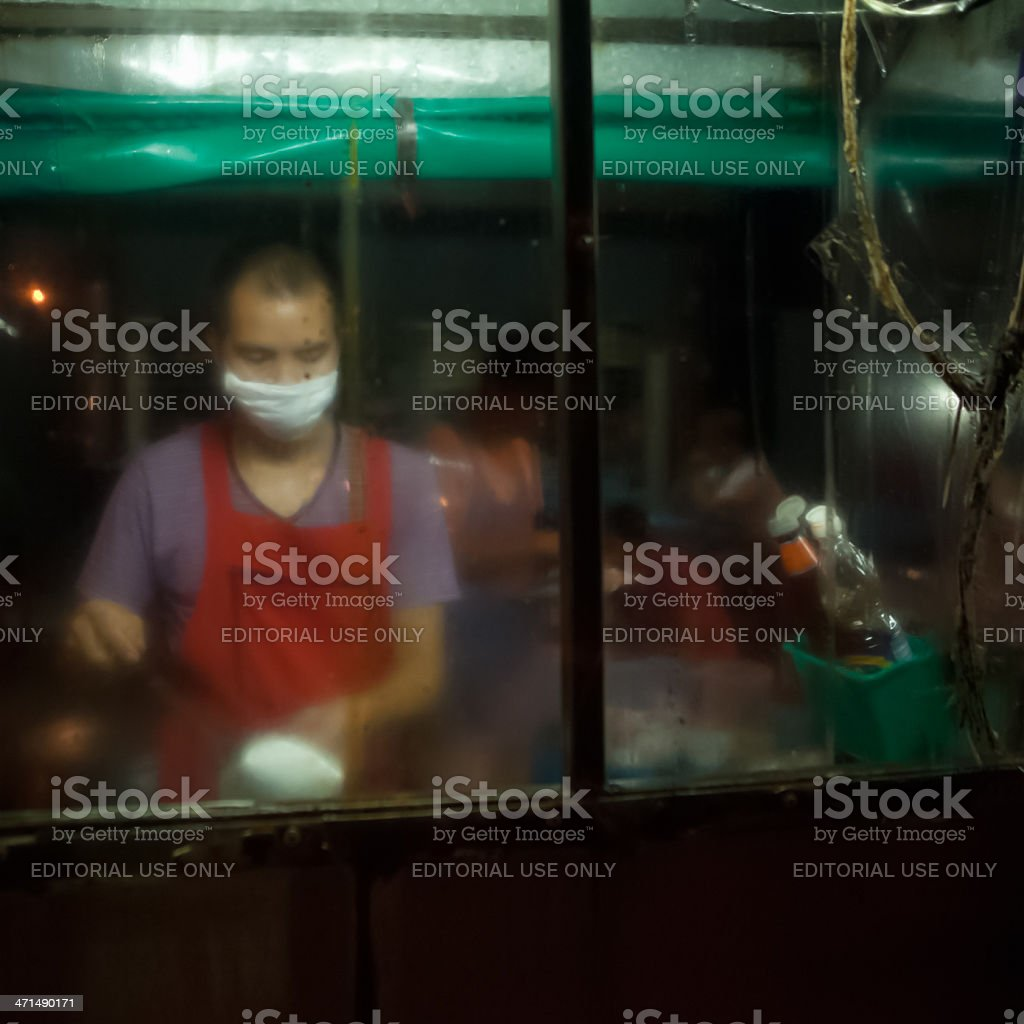 Thai Food Vendor Working Amongst the Steam royalty-free stock photo