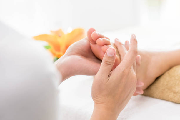 Thai foot massage with aroma therapy and reflexology A customer receiving a Thai foot massage with reflexology and aroma therapy. foot massage stock pictures, royalty-free photos & images
