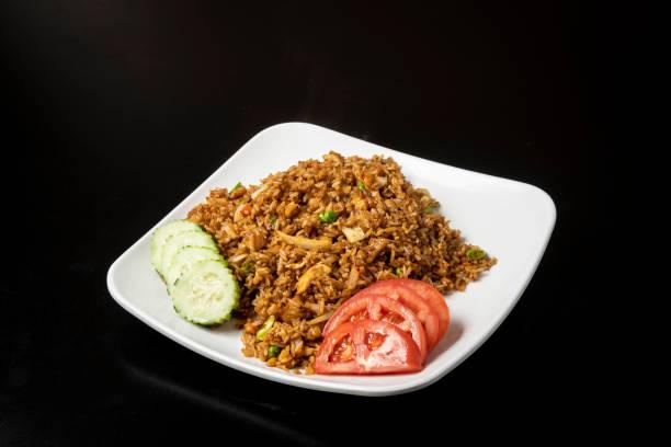 Tay kızarmış pirinç gıda yürütmek stok fotoğrafı