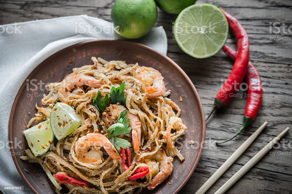 Thai fried rice noodles with shrimps stock photo