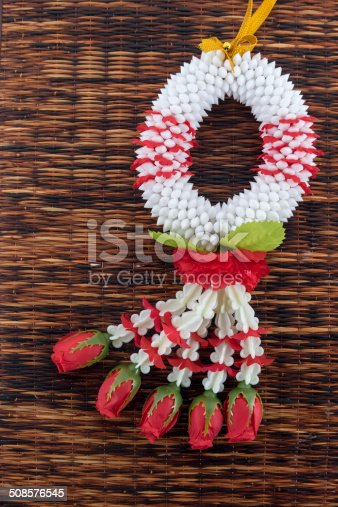 istock thai garland on thai mat 508576545