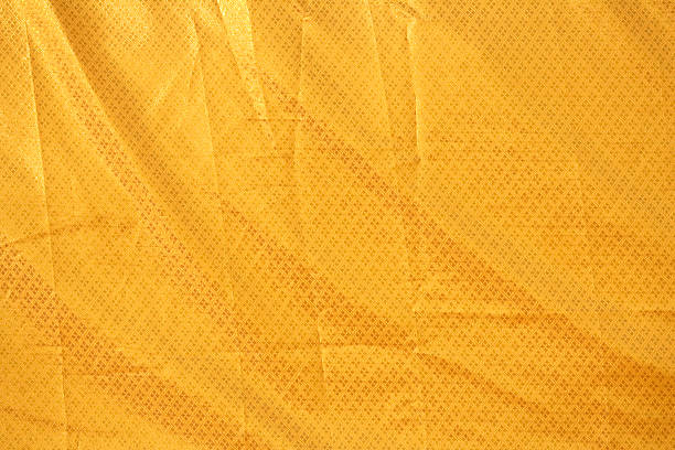 thai gold colored fabric texture pattern - nylon texture stock pictures, royalty-free photos & images