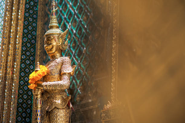 Thai golden statue in standing position outside of Wat Pho, Bangkok Thai golden statue in standing position outside of Wat Pho, Bangkok chiang mai province stock pictures, royalty-free photos & images