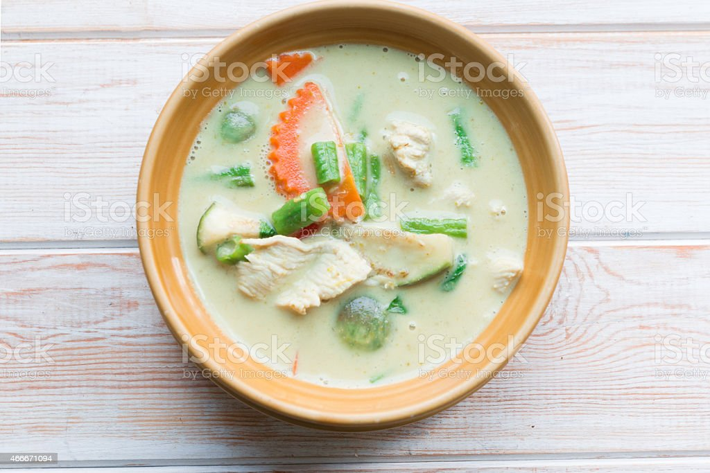 Thai green curry intense soup with chicken stock photo