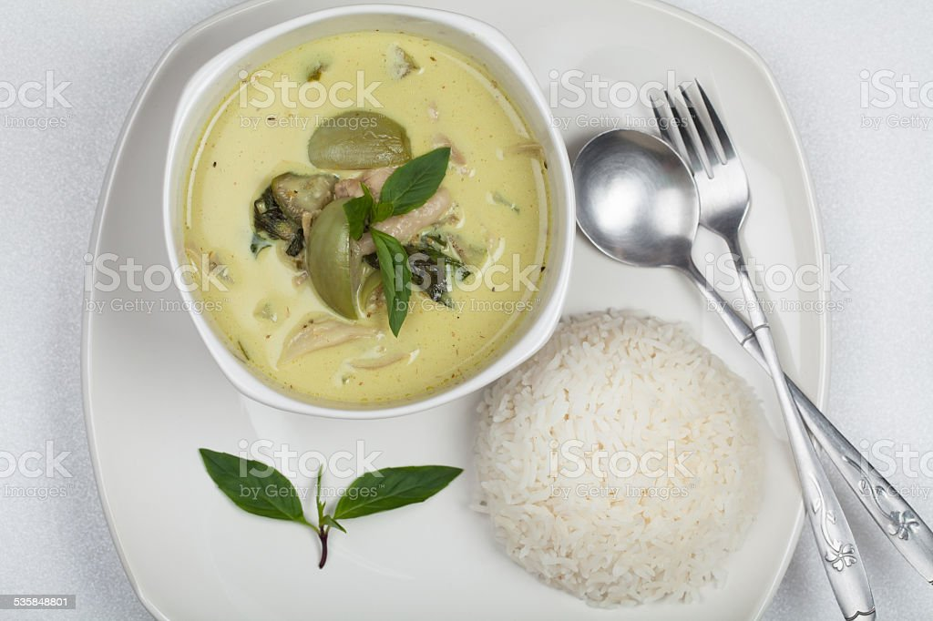 Thai green curry ready for serve with rice stock photo