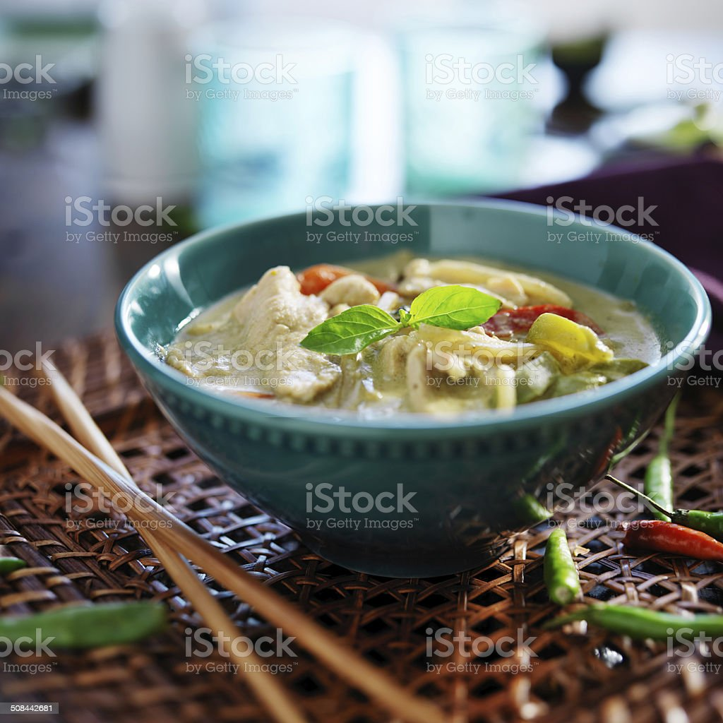 thai green curry with chicken in bowl stock photo