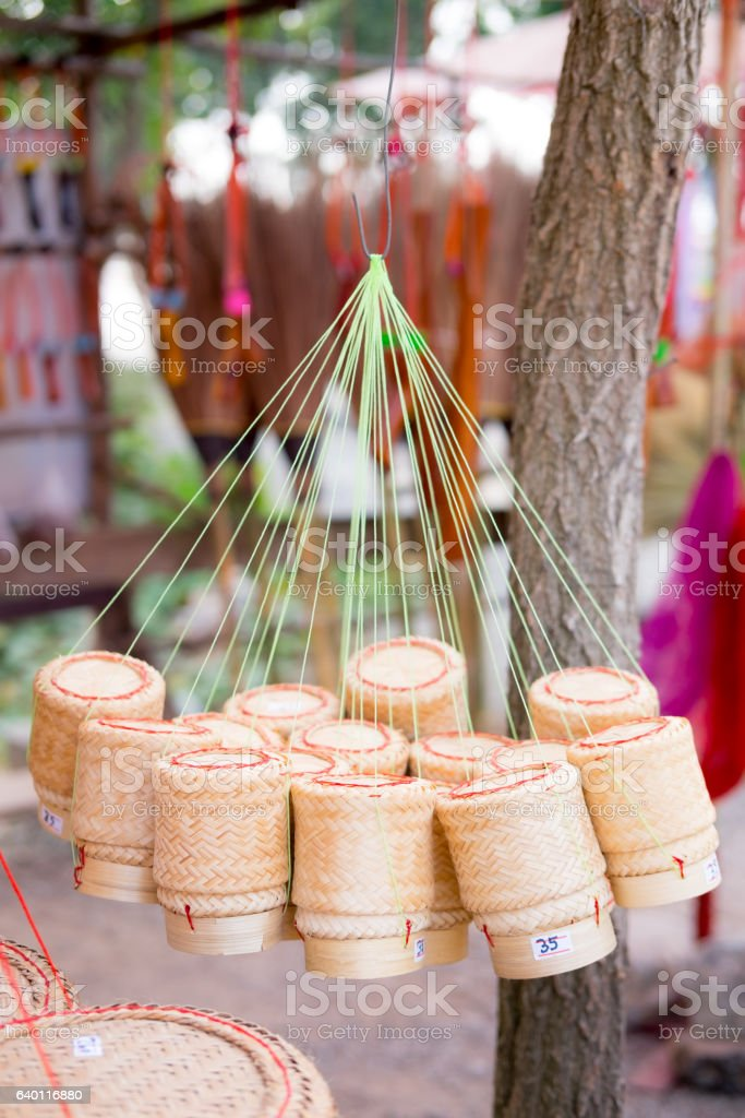 Thai handmade container for sticky rice made from bamboo stock photo