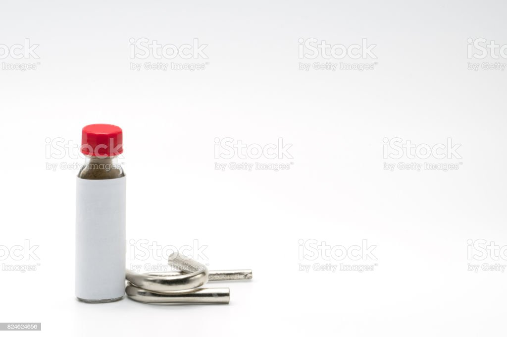 Thai herbal powder snuff in classic bottle with red cap and two snuff tube made of steel and chrome stock photo