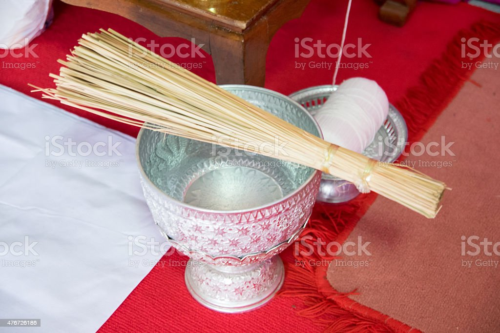 Thai holy water in water dipper stock photo