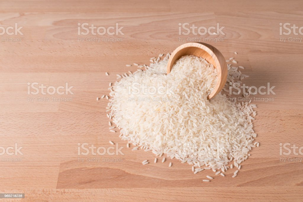 Thai jasmine rice on wood table royalty-free stock photo