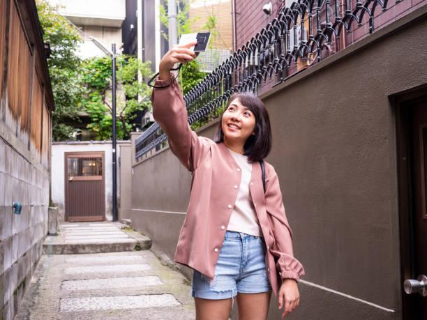 Thai Lady taking selfie at old street in Tokyo. stock photo
