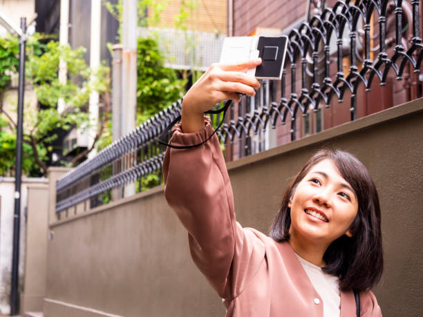 Thai Lady taking selfie at old town in Tokyo. stock photo