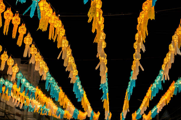thai lanna style paper hanging lamp decorate the lantern festival area. - dazzlingly stock pictures, royalty-free photos & images