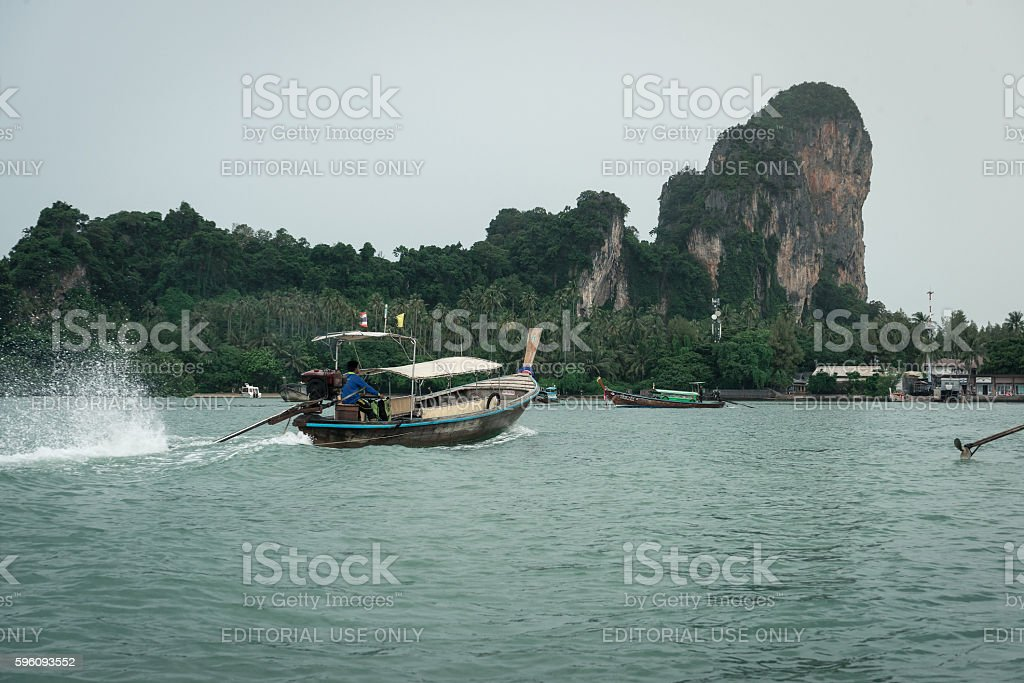 Thai long tail boats in sea with mountain and forest royalty-free stock photo