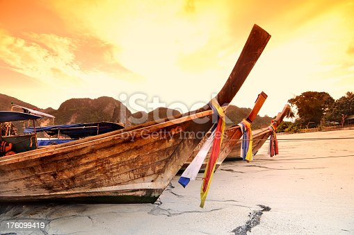 Longtail boats on a Thai beach.