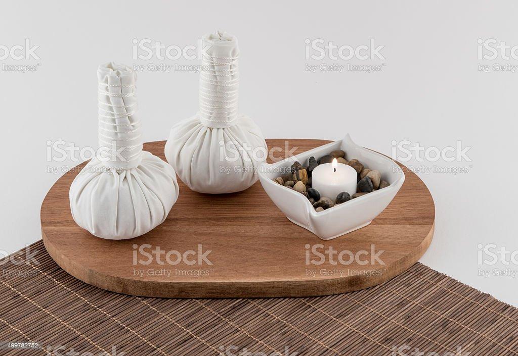 Thai Massage Balls with Aromatherapy Candle stock photo