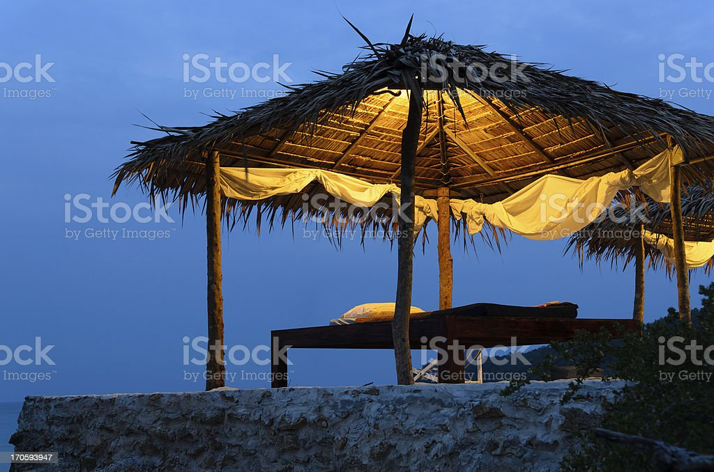Thai massage hut near the sea in evening time stock photo