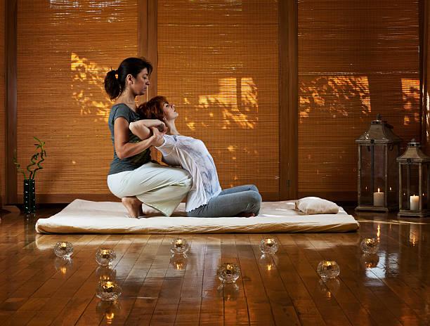 thai massage - thai massage stock photos and pictures