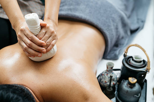 Thai massage series : Back and shoulder massage stock photo