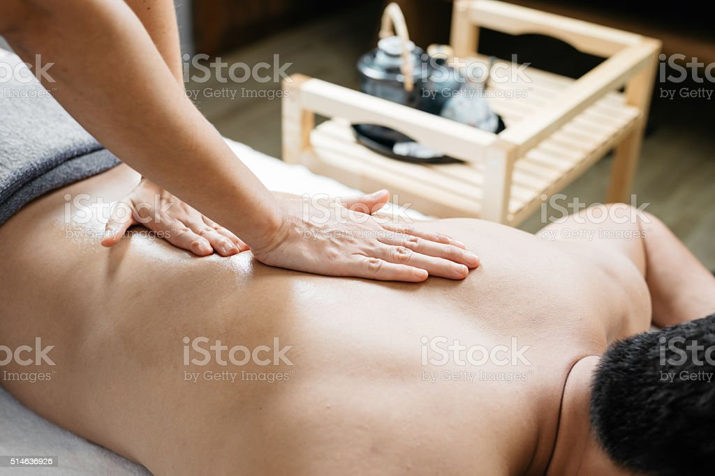 Thai massage series : Back and shoulder massage stock photo