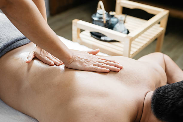 thai massage series : back and shoulder massage - thai massage stock photos and pictures