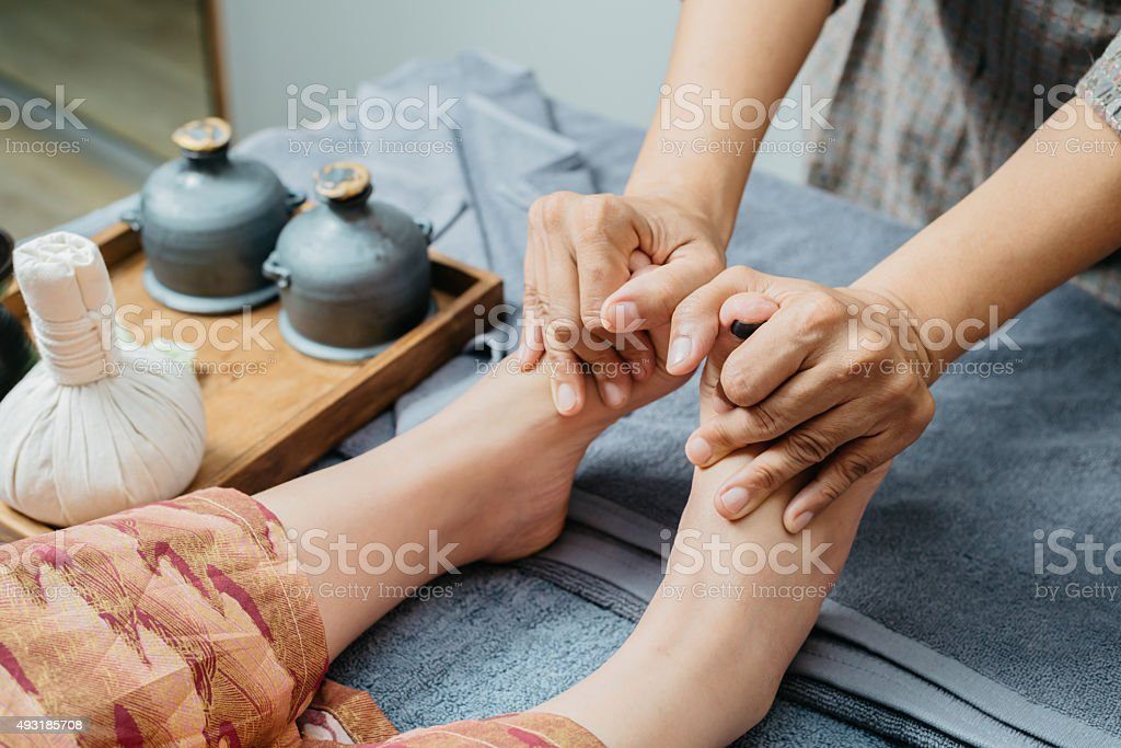 Thai massage series : Foot and leg massage stock photo