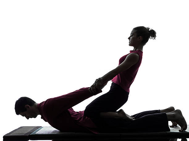thai massage silhouette - thai massage stock photos and pictures