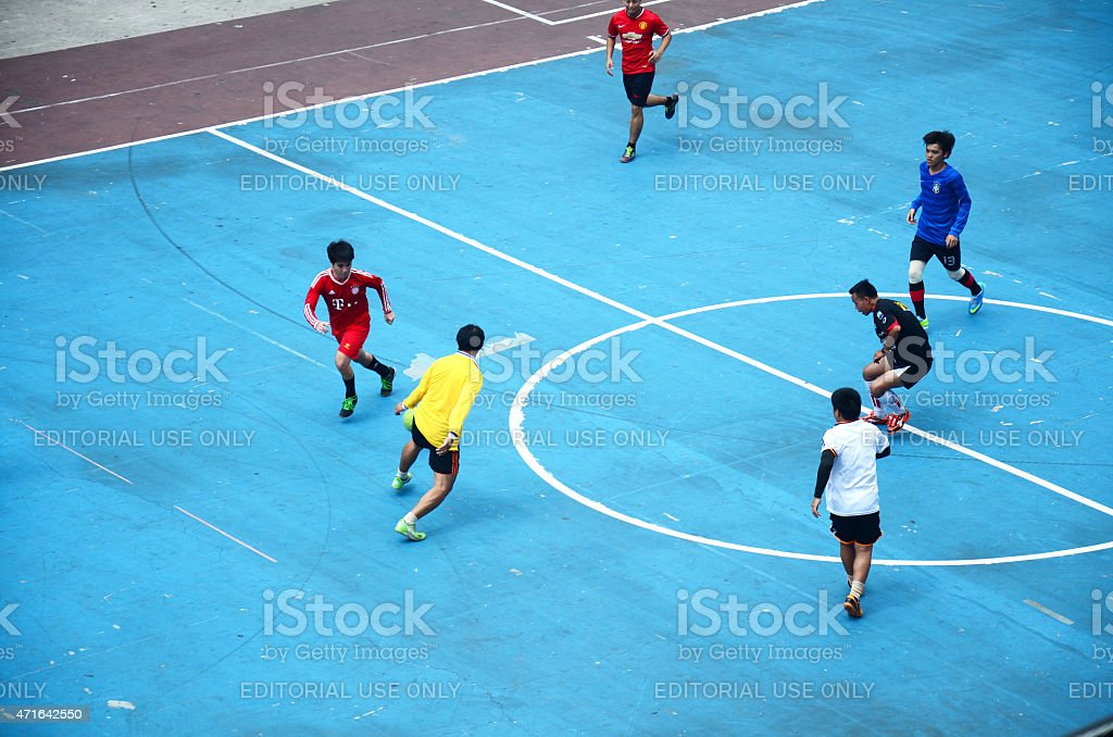 Thai men playing football or soccer stock photo
