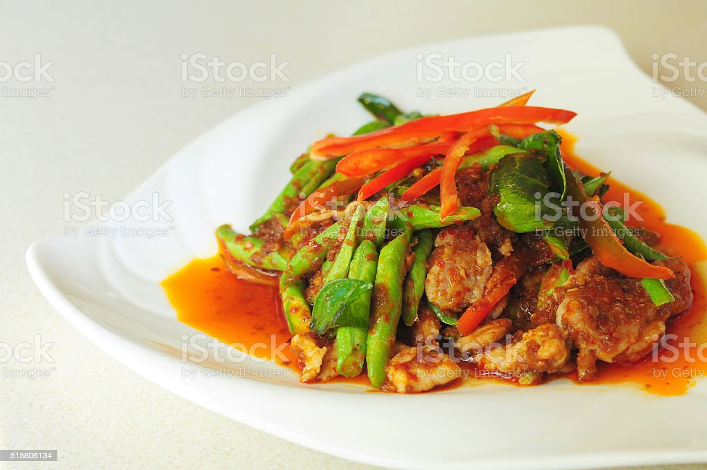 Thai menu of spicy chicken and long bean stir-fried stock photo