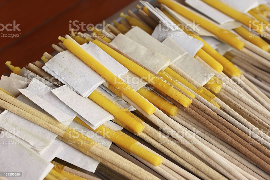 Thai merit making, incense and candles royalty-free stock photo