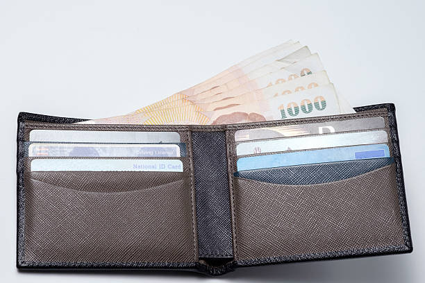 thai money and credit card in lather wallet . stock photo
