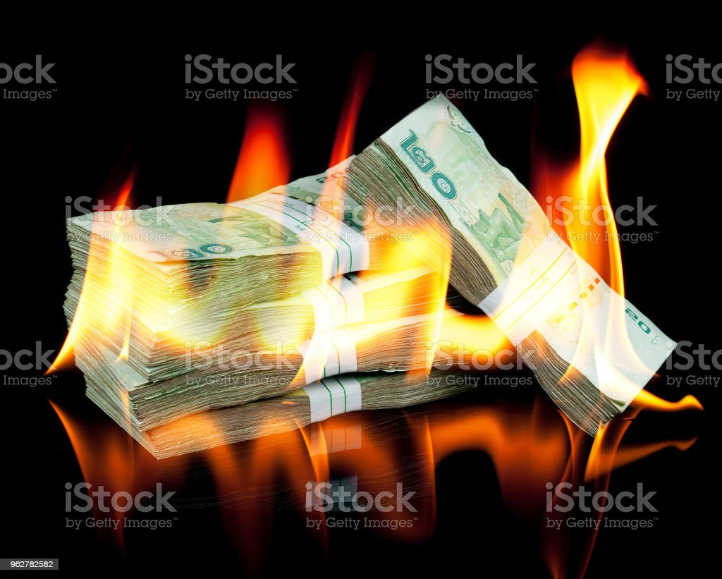 Thai money bill on fire with black background stock photo