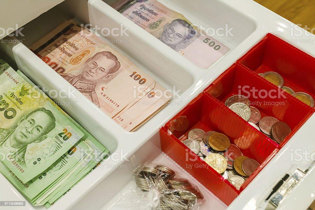 thai money in the cash drawer stock photo