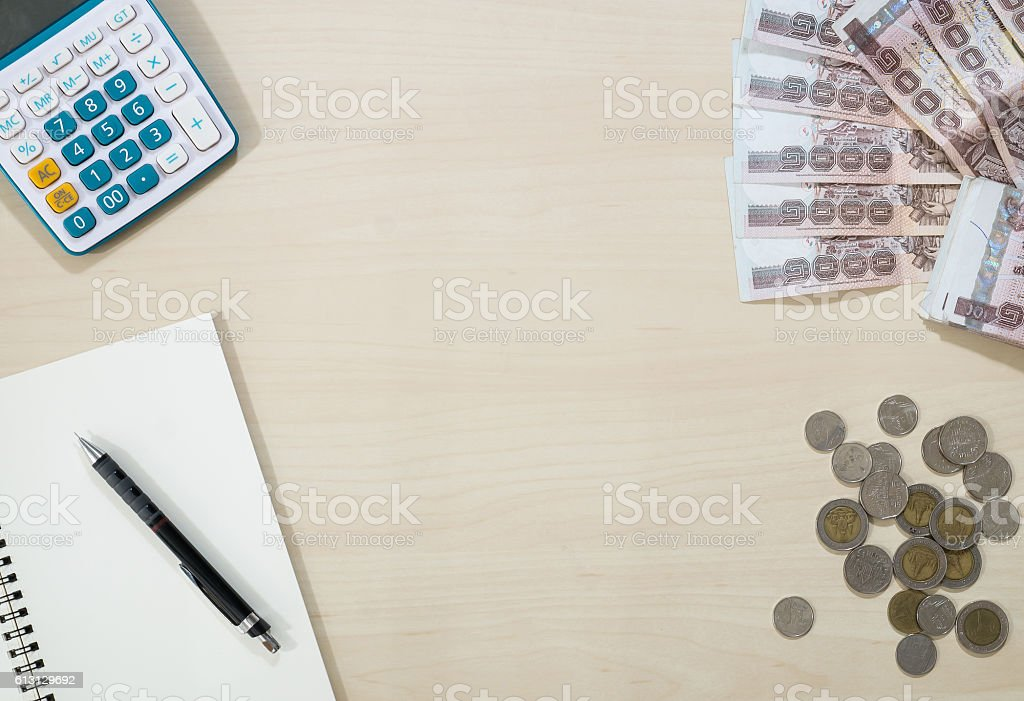 Thai money - Thai baht currency and Calculator, notebook, pencil stock photo