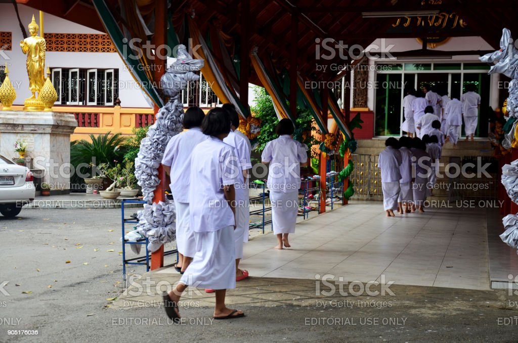 Thai people and children ordain as a nun and Brahmin for practice the dharma stock photo