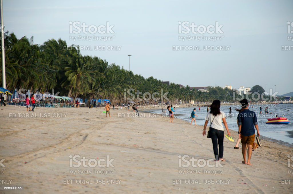 Thai people and lovers walking on the beach royalty-free stock photo