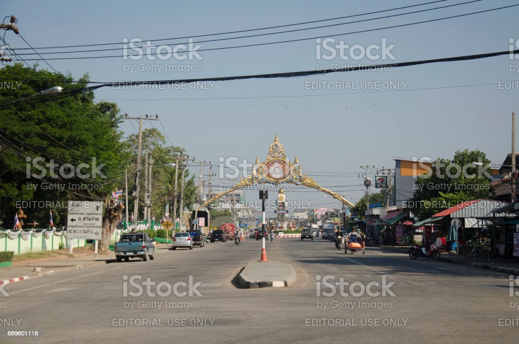 Thai people riding motorcycle and driving car on the street stock photo